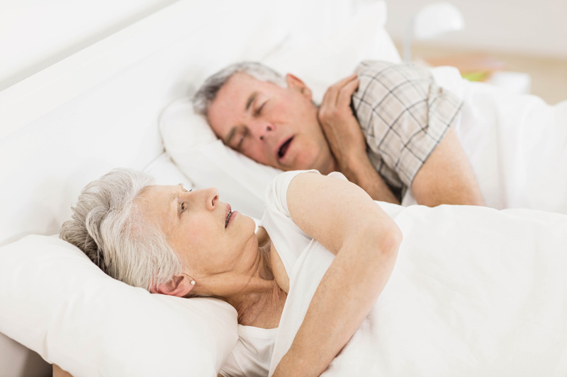 Older Couple Snoring