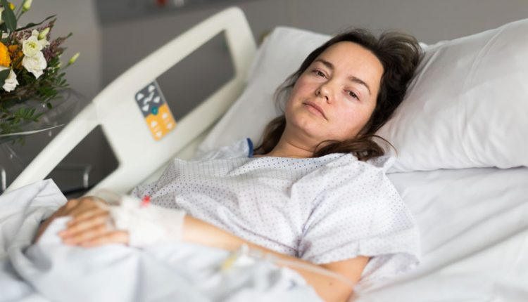 Sick Woman in Hospital Bed